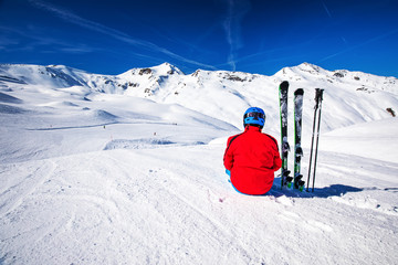 Wall Mural - Skier posing in famous ski resort in Alps, Livigno, Italy, Europe.