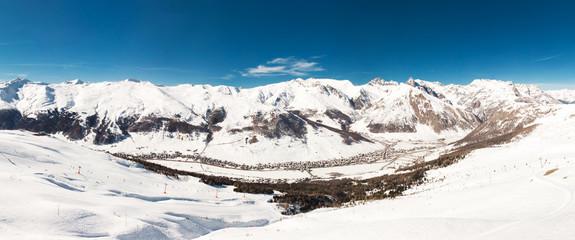 Wall Mural - LIVIGNO, ITALY - Feb. 2019 - Skiers skiing in Carosello 3000 ski resort, Livigno, Italy, Europe