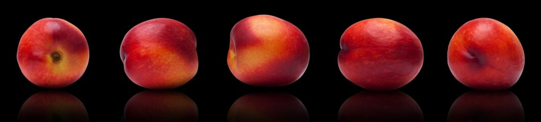set of juicy, ripe plums isolated lie on a black background