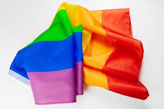 waving lgbt rainbow flag isolated on white