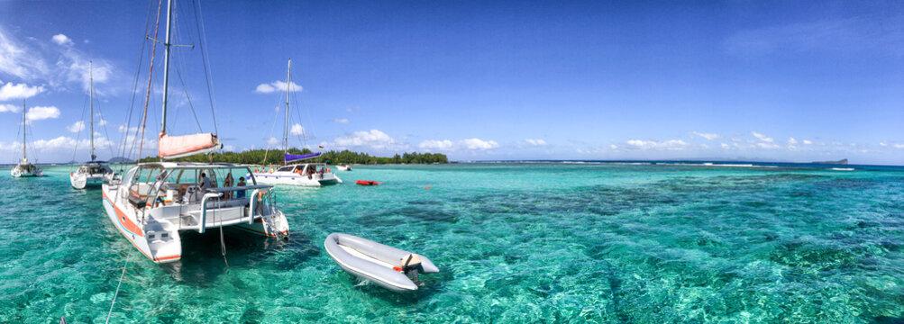 Catamarans anchored near a beautiful beach, panoramic view