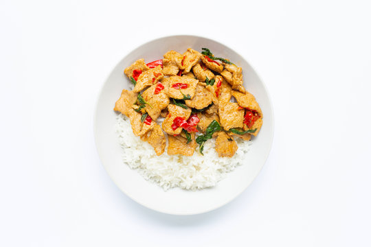 Rice with stir-fried hot and spicy pork with holy basil on white