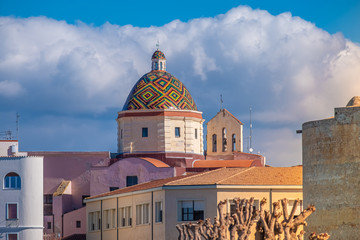 Majolica tiled cupola of Jesuit church of San Michele, Alghero (L'Alguer), Sardinia, Italy.  Famous for the beauty of its coast and beaches and its historical city center.