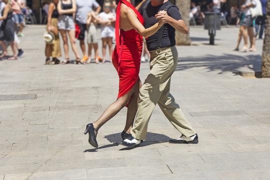 Street couple dancers performing Argentine tango dance