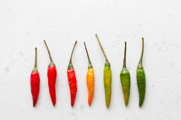 Canvas Prints Hot chili peppers Red Hot Chili Peppers On Background or White Table. A Lot of Red Chilli Peppers. Green, Yellow Hot Chili Peppers. Copy space for your text. Flat lay, top view. Colorful chili pepper rainbow. Gradient