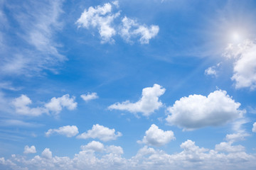 Beautiful white clouds with sun on blue sky.Color shade gradient from white to blue for background wallpaper. Fototapete
