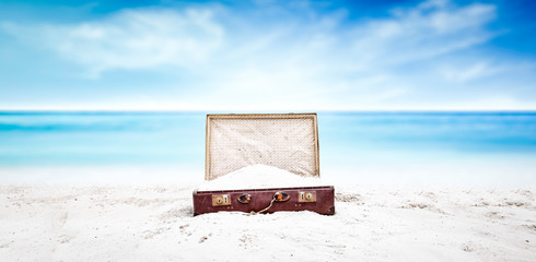 Summer suitcase of sand and beach