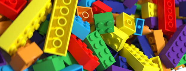 Colored toy bricks background. Rainbow colors. 3D Rendering