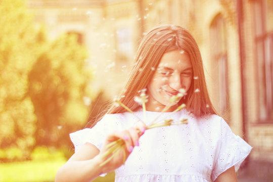 happy, joyful girl with dandelion.positive emotions, summer walk in the park