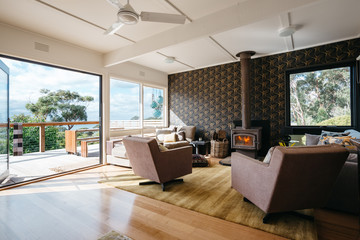 Beach house living room with bi fold doors opening onto a view