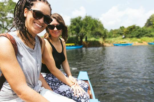 Women Riding On A Boat Through A Marsh