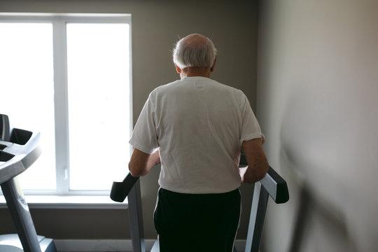 Old man on treadmill