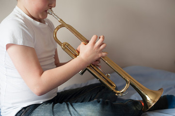 boy with trumpet musical instrument