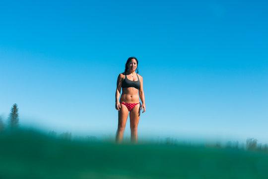 A woman standup paddle boarding