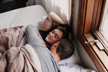 Couple Waking Up In Bed Together