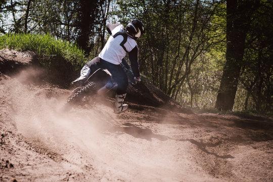 Motocross driver turning
