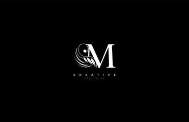 Initial M letter luxury beauty flourishes ornament monogram logo