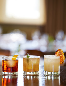 Mixed artisan cocktails in restaurant and bar