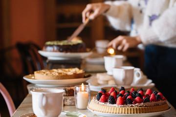 Woman preparing sweet table for teatime