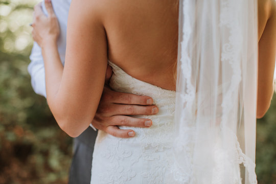 Closeup of Bride and Groom's Embrace