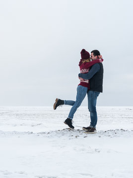Couple embracing on winter field