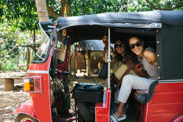 Women Sitting In The Back Of A Tuk Tuk Taxi