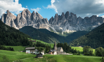 Santa Magdalena church paints a fairytale picture.  Dolomites. Italy
