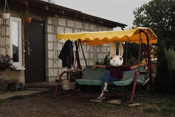 Halloween rabbit sitting on swing
