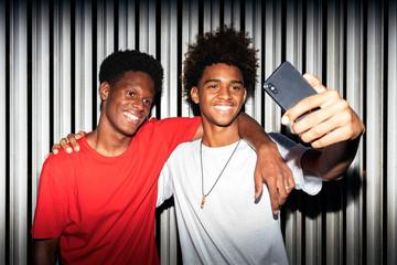 Two black race friends having fun