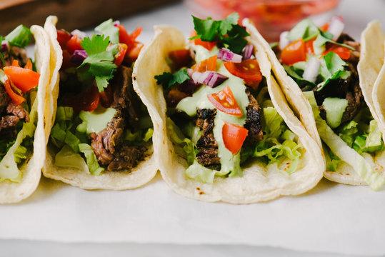 Lined up Steak Tacos