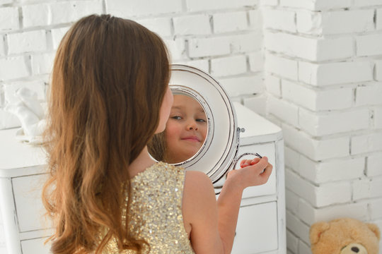 reflection in the mirror young girl