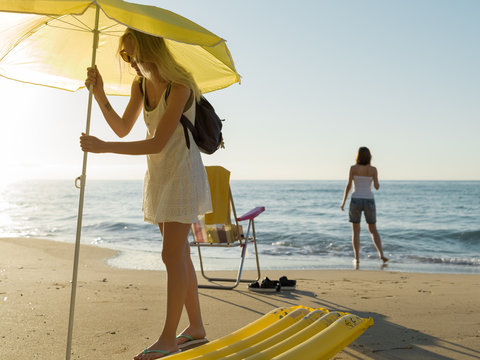 Women starting chill time on beach