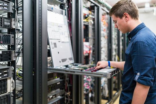 Teenager working in server room