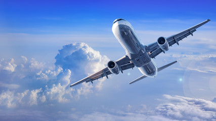 modern airliner flies between clouds