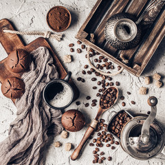 Fototapete - Coffee beans with coffee and muffins on grey textured background.