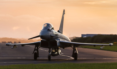 Backlit Typhoon taxis out for takeoff Fototapete