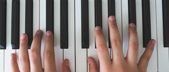 piano keys and playing piano
