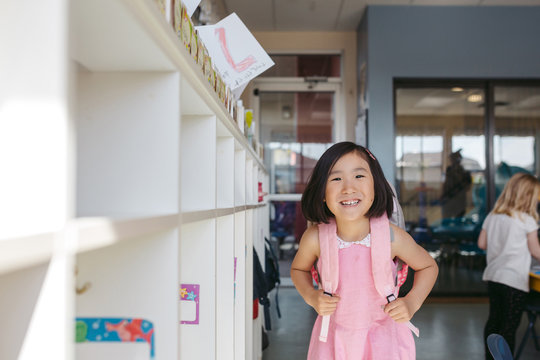 Smiling young kid in classroom