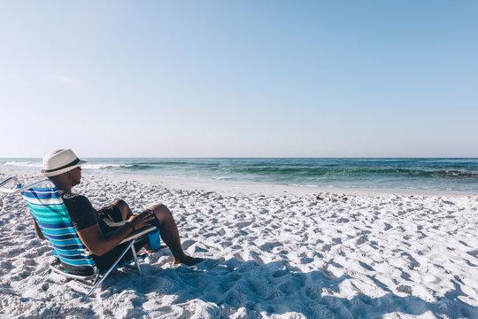 Black man relaxing on the beach