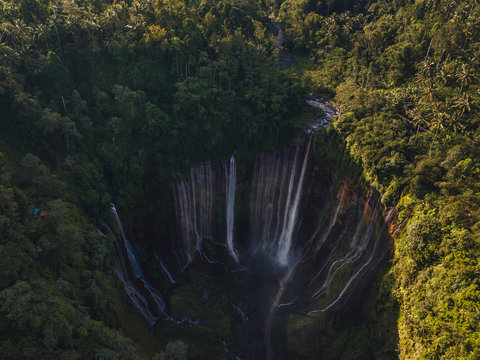 huge waterfall in tropical lush jungle from above