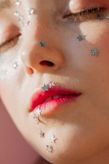Portrait of woman with silver stars on face