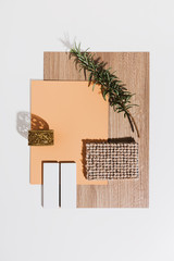 Peach and oak interior mood board with gold accent