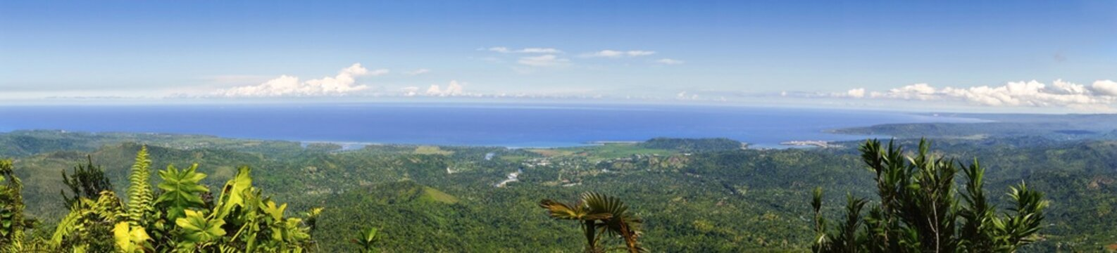 Wide Angle Panoramic Landscape View of Baracoa Bay and Atlantic Ocean Coastline from summit of El Yunque Mountain Cuba