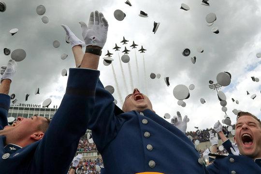 Cadets toss their caps during U.S. Air Force Academy's graduation ceremony in Colorado Springs, Colorado