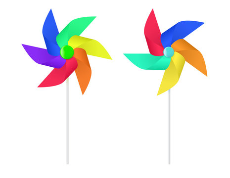 Multi colored toy paper windmill propeller.