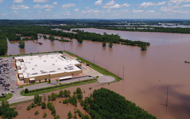 A building sits submerged in the flood waters of the Arkansas River in this aerial photo in Fort Smith, Arkansas