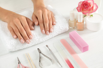 Woman waiting for manicure and tools on table, closeup. Spa treatment