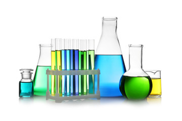Fototapete - Set of different lab glassware with color liquid isolated on white