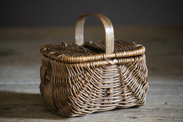 old wicker woven picnic basket