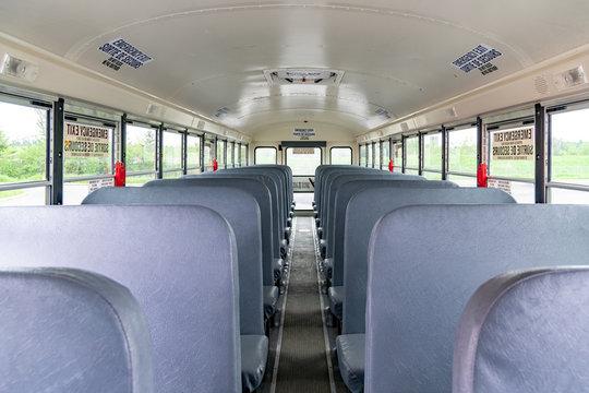 Empty seats inside a school bus